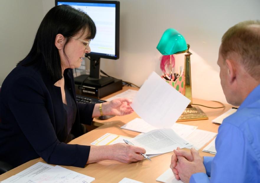 Doctor explaining results at a desk
